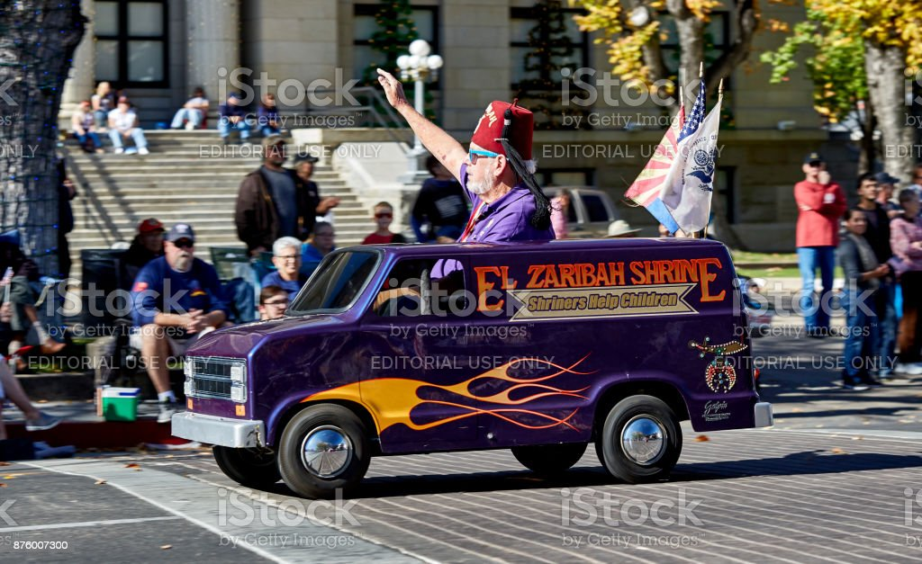 Man driving Toy Van in Veterans Day Parade stock photo