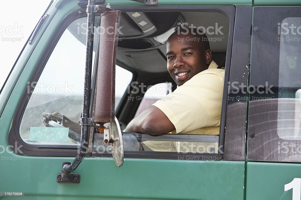 Man driving truck stock photo