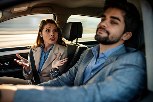 istock A man driving while a female passenger is fussing about 1132342218