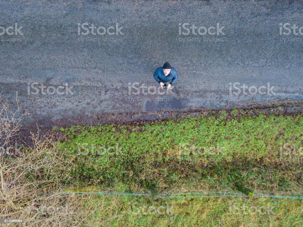 man droning in the countryside stock photo