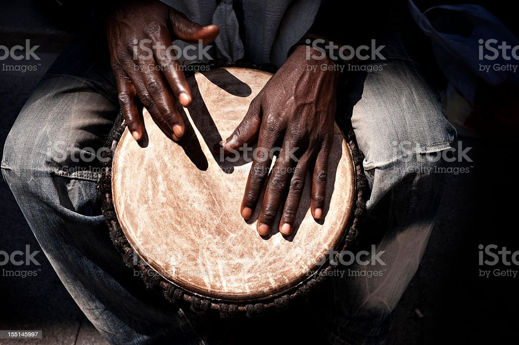 Man drumming on an African drum stock photo