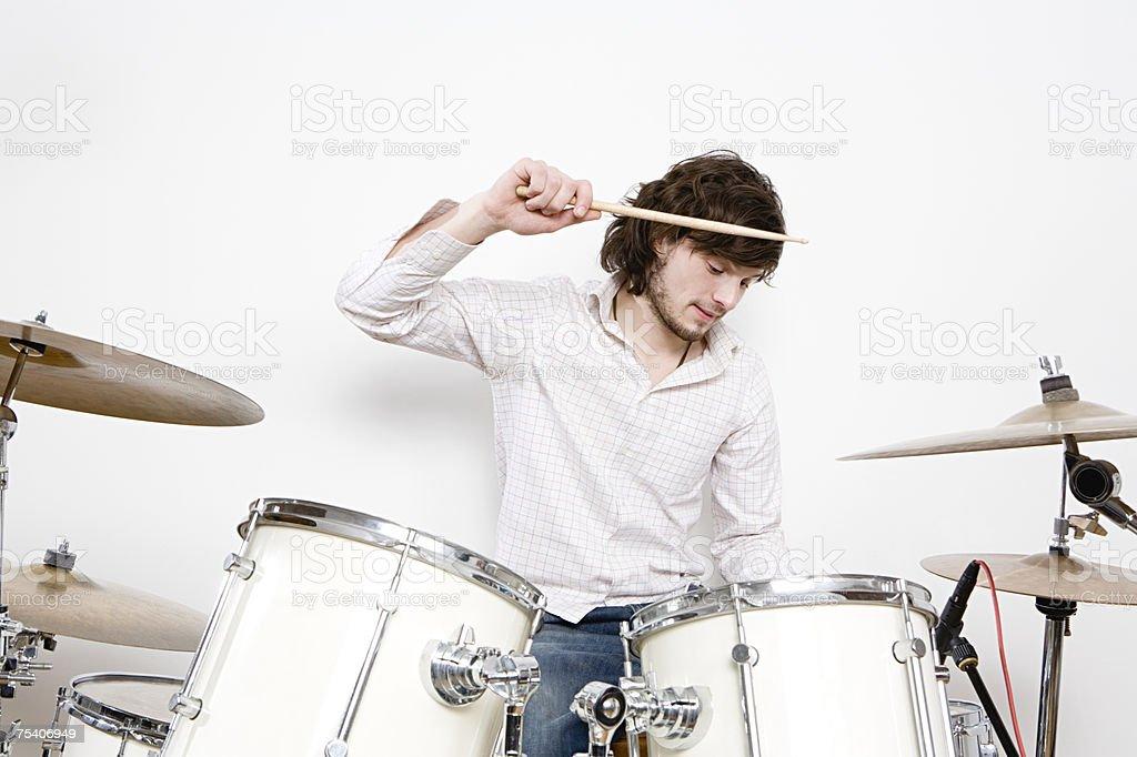 A man drumming stock photo