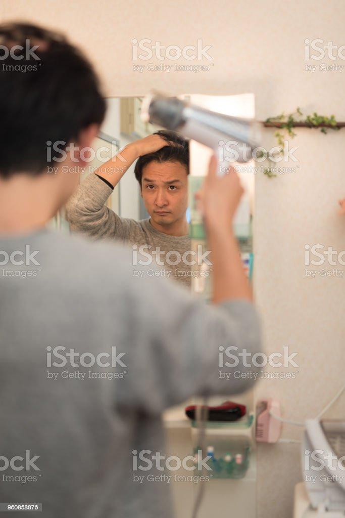 man drying hair stock photo