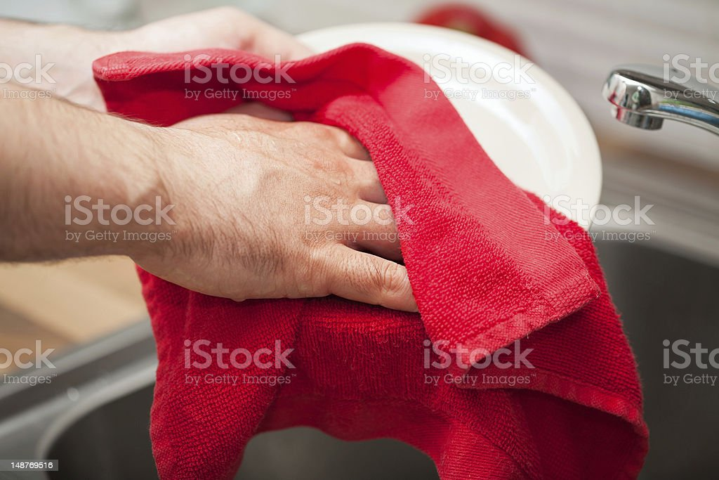 man drying the dishes man drying the dishes Adult Stock Photo