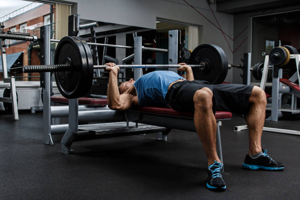 Man during bench press exercise stock photo