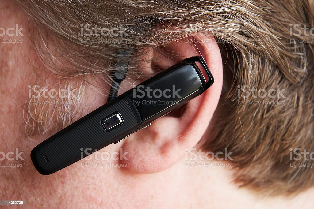man ear with bluetooth stock photo