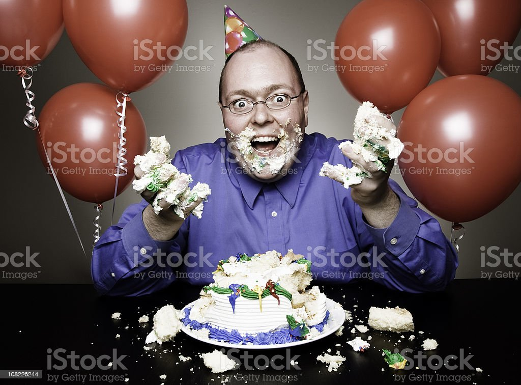 Sensational Man Eating Birthday Cake Stock Photo Download Image Now Istock Funny Birthday Cards Online Inifofree Goldxyz