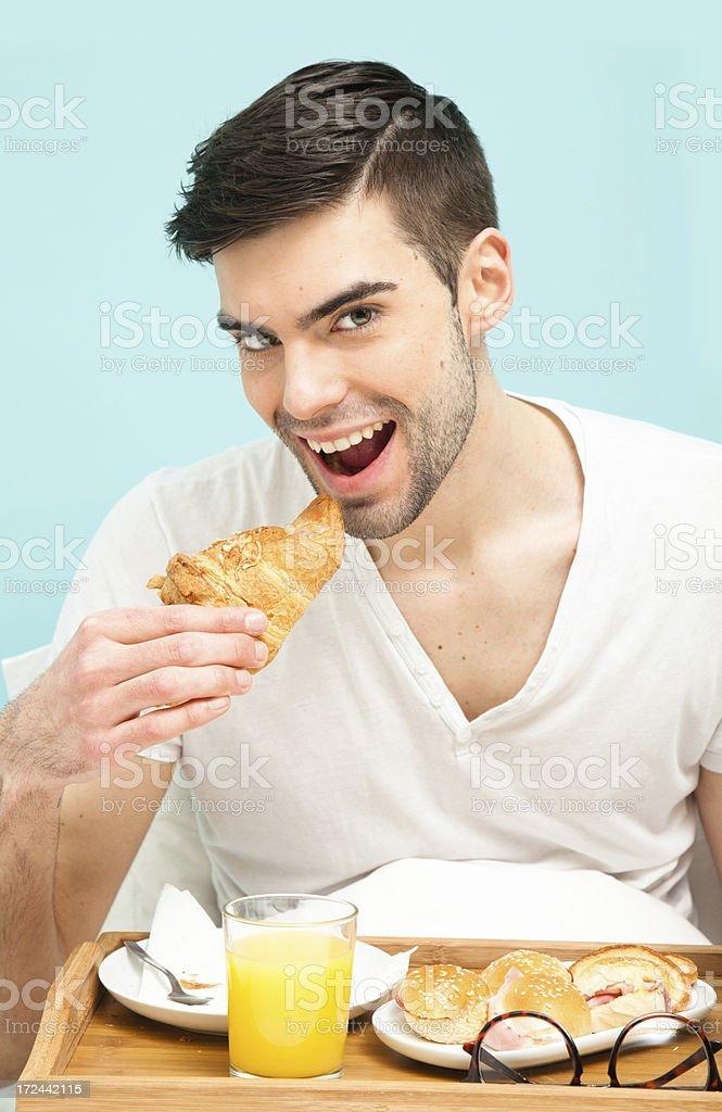 Man eating breakfast royalty-free stock photo