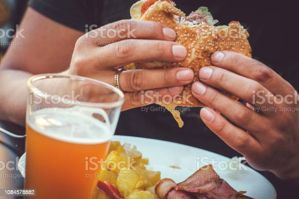 Man eating burger picture id1084578882?b=1&k=6&m=1084578882&s=612x612&h=r 0k6j2ryt1mw9a6g8gieubygliieqpy zthav2kdsw=