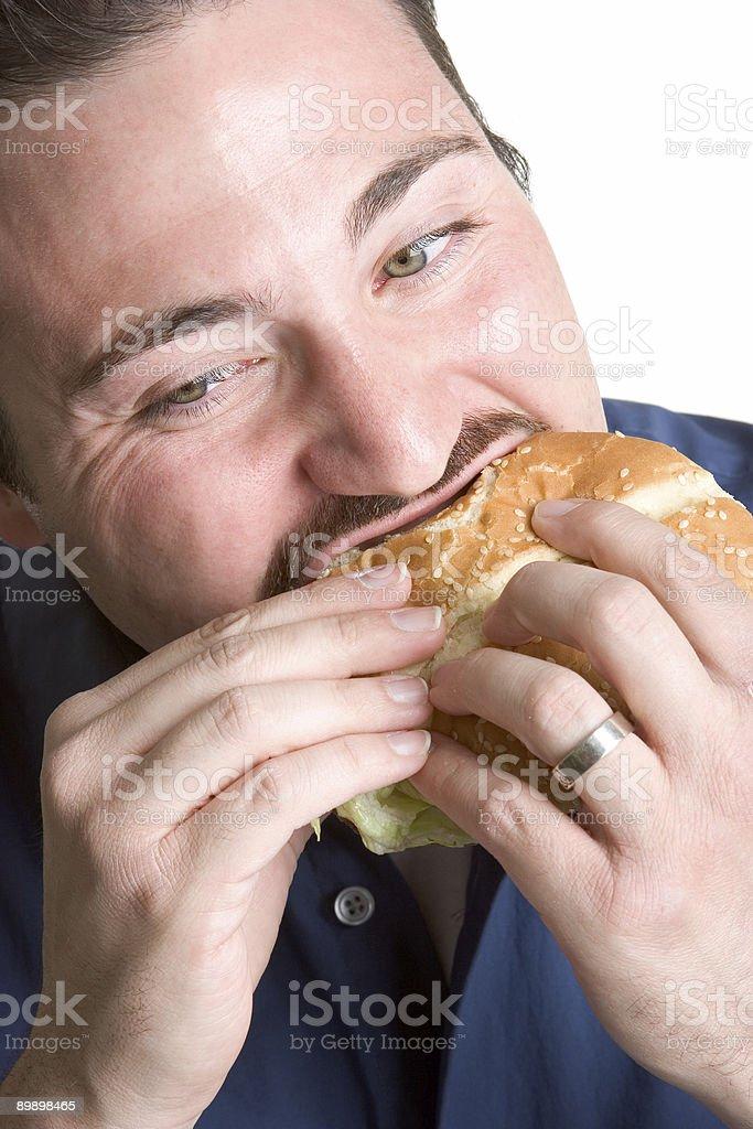 Man eating burger royalty-free stock photo