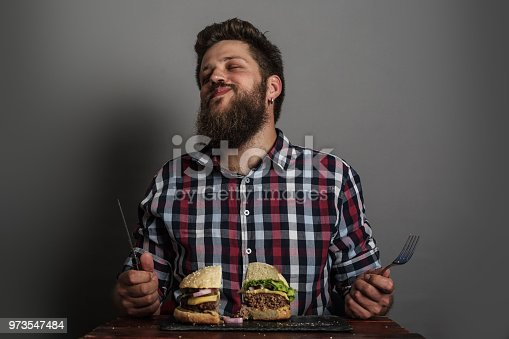 Man eating fresh self made burger close up