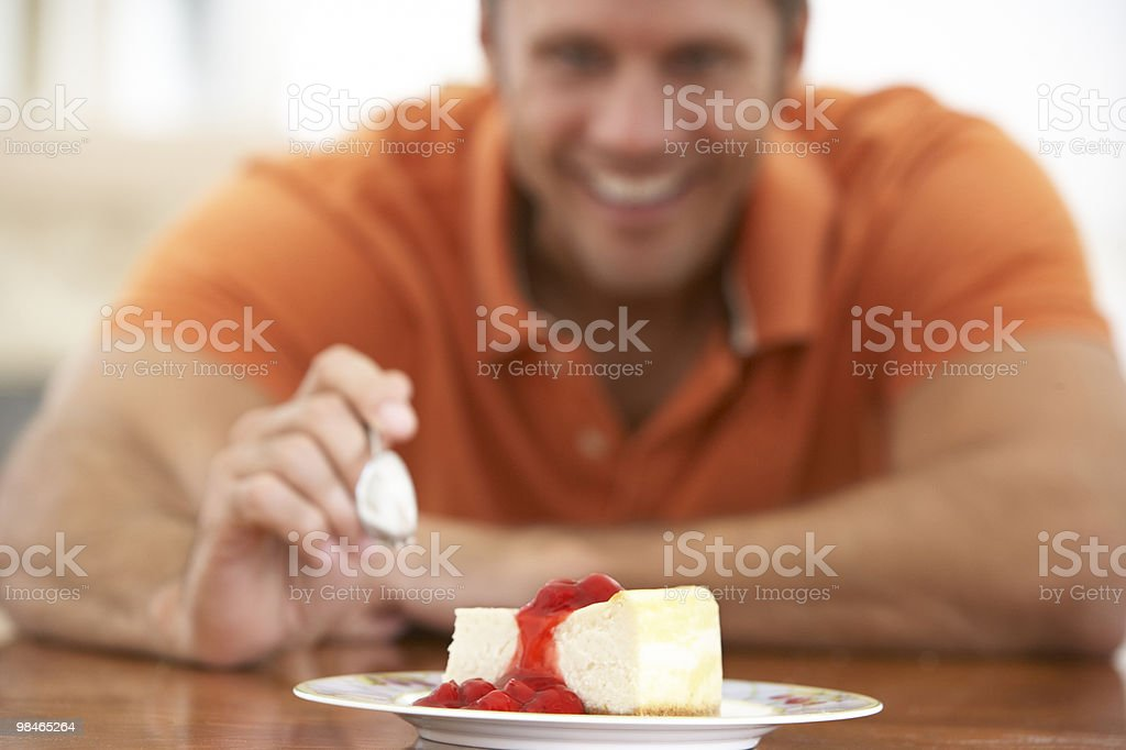 Man Eating Cheesecake royalty-free stock photo