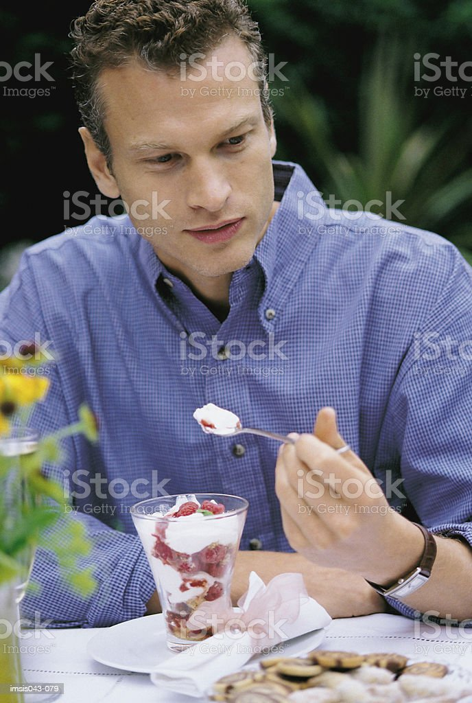 Man eating dessert royalty-free stock photo