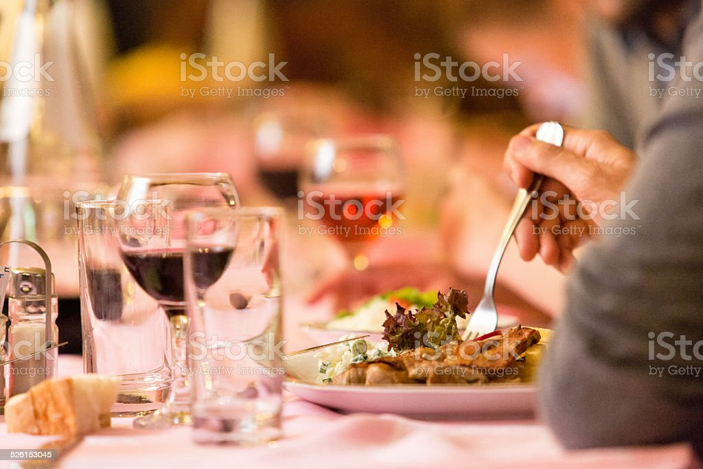 Man eating dinner at the restaurant stock photo