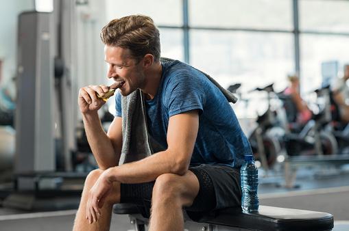 istock Man eating energy bar 679306088