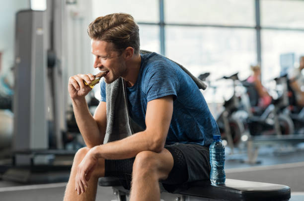 Man eating energy bar stock photo