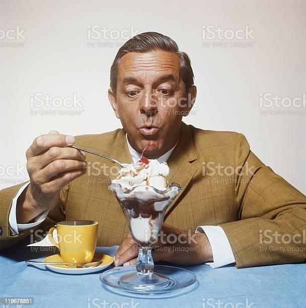 Man eating ice cream picture id119678851?b=1&k=6&m=119678851&s=612x612&h=qnfarqcekkbow8oaqe6uktpknblc2qisb5n8slkggea=