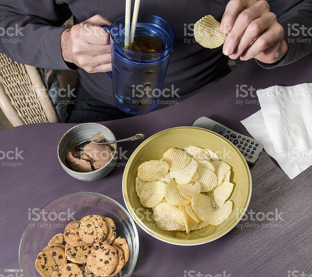 man eating junk food stock photo