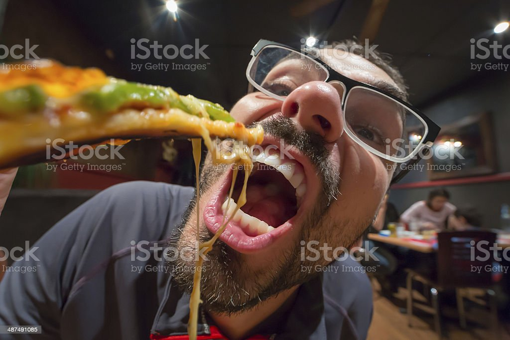 Man eating pizza in a restaurant, funny - Royalty-free Adult Stock Photo