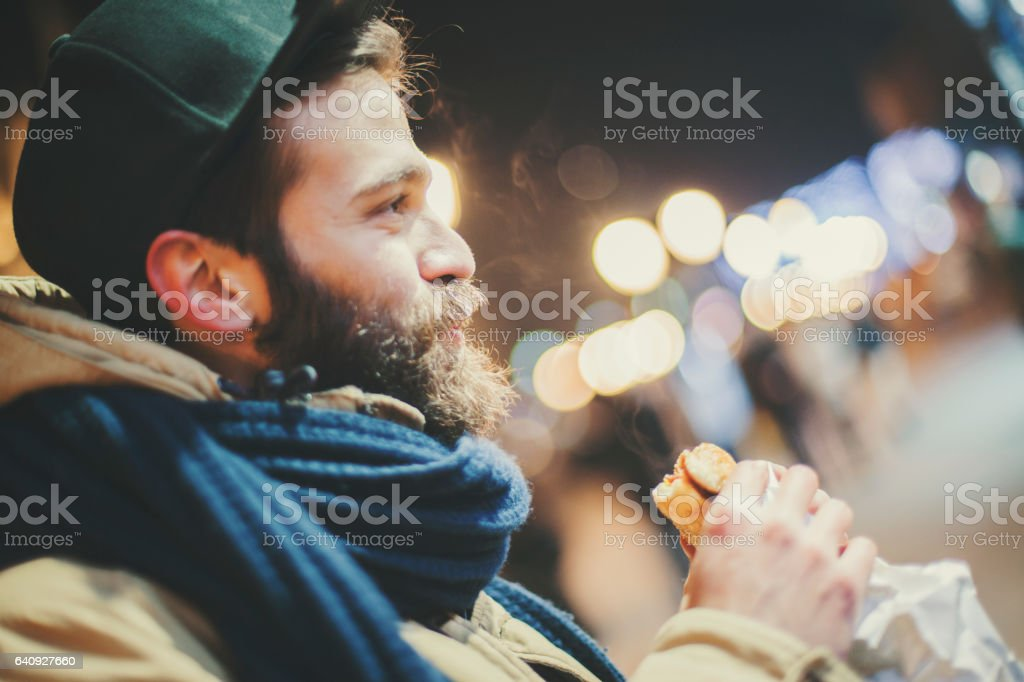 Man eating sandwich stock photo