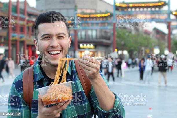Man eating street food in asia picture id1144841165?b=1&k=6&m=1144841165&s=612x612&h=egciq92mrmho xot4ousz kuikey0kelqram3cd7jg4=