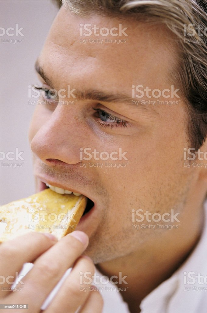 Man eating toast royalty-free stock photo