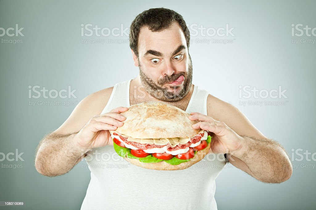 Man eats an enormous roll royalty-free stock photo
