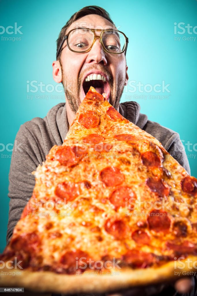 Man Eats Oversized Pizza Slice stock photo
