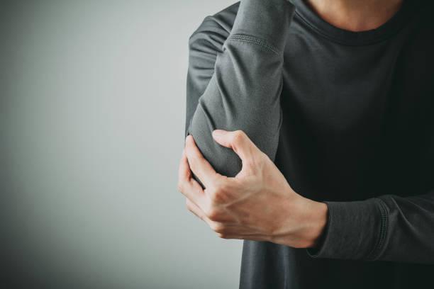 man elbow pain stock photo