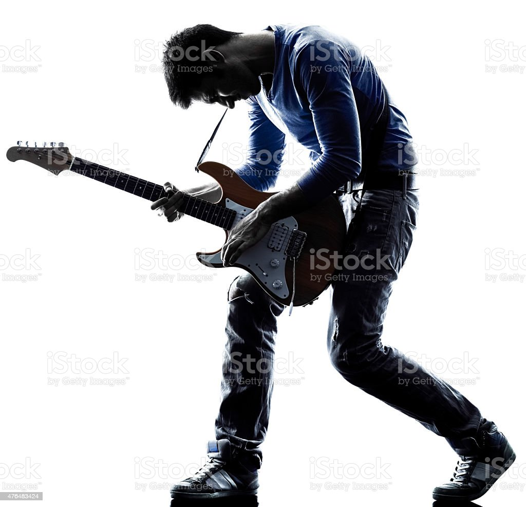 man electric guitarist player playing silhouette stock photo
