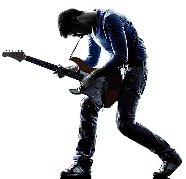 man electric guitarist player playing silhouette one caucasian man electric guitarist player playing in studio silhouette isolated on white background guitarist stock pictures, royalty-free photos & images