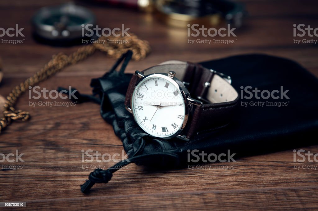 man elegant watch on wooden table background