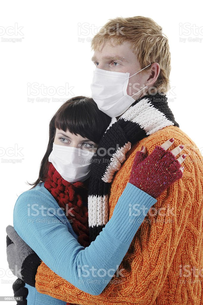 man embraces a woman wearing masks, flu, A(H1N1) royalty-free stock photo
