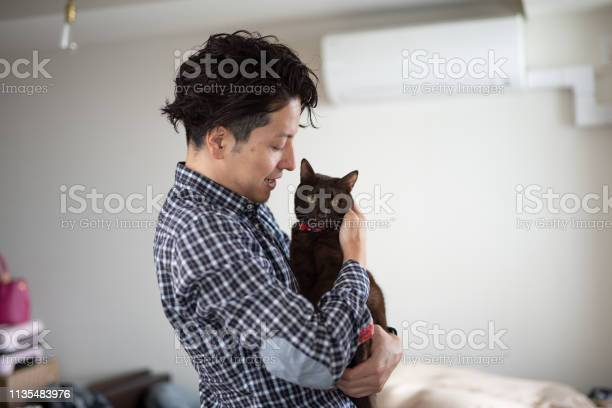 Man embracing cat in sleeping room picture id1135483976?b=1&k=6&m=1135483976&s=612x612&h=nkj pndj1iam5u49412gte3mqlenjishh2mu6qx1d50=