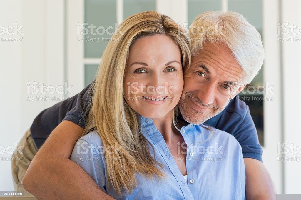 Man embracing woman stock photo