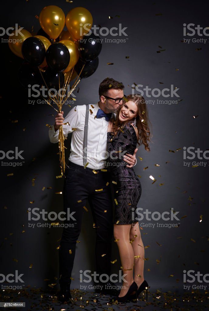 Man embrancing and kissing  ecstatic woman stock photo