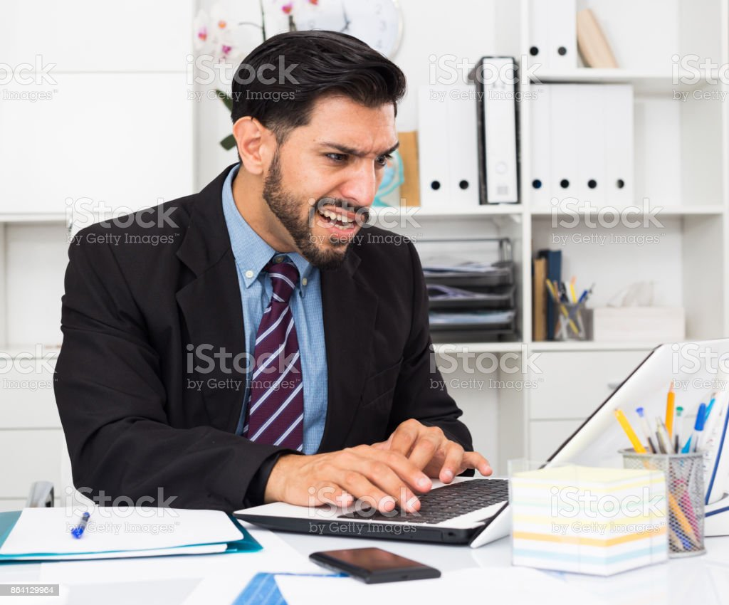 Man employee is indignant because he is having issues with project royalty-free stock photo