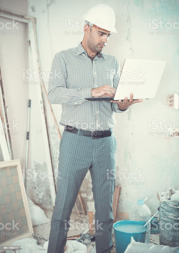 Man engineer managing process with laptop royalty-free stock photo