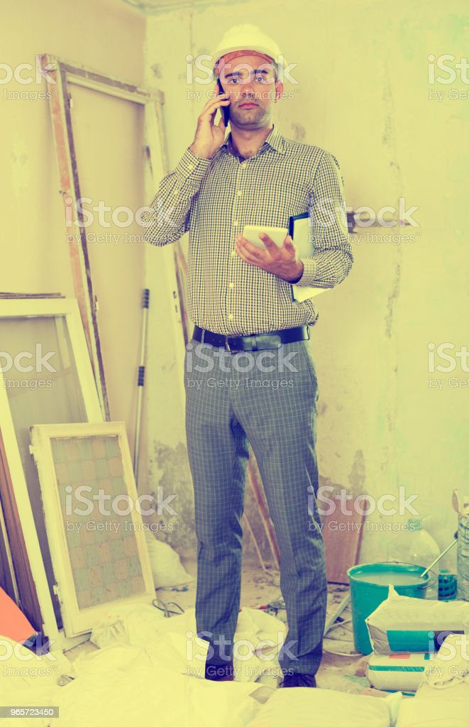 Man engineer talking on the mobile phone - Royalty-free Adult Stock Photo