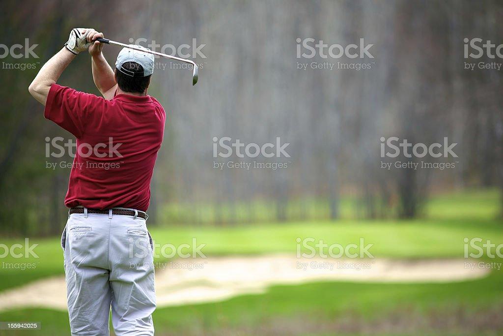 man enjoying a game of golf stock photo