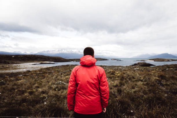Man enjoying a view of beautiful Tierra Del Fuego landscape stock photo