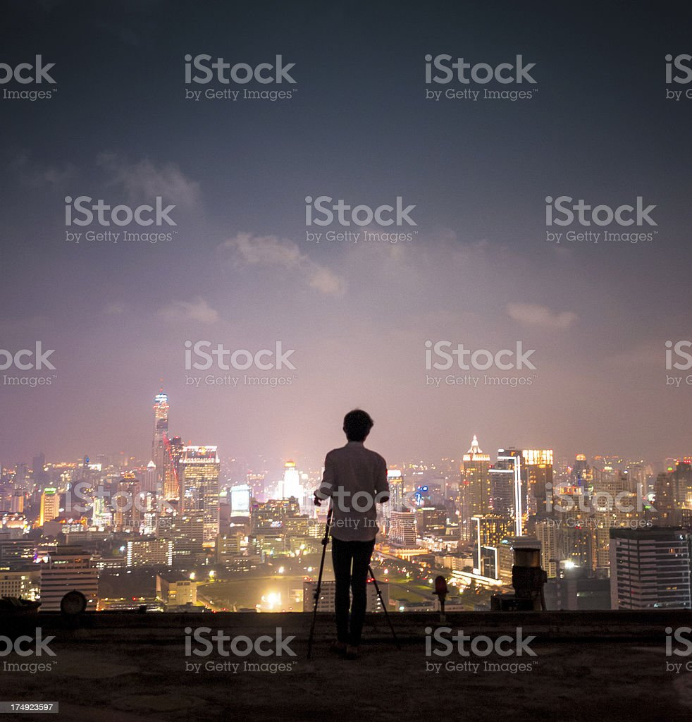 Man enjoying aerial cityscape of Asia stock photo