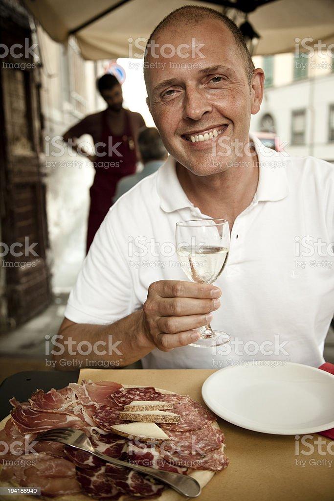 Man enjoying an antipasto in Italy royalty-free stock photo