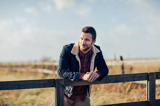 man enjoying country living - country fashion stock photos and pictures