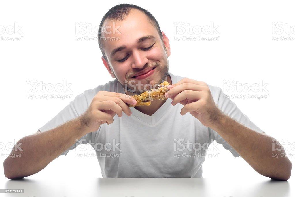Man enjoying fried chicken drum on white table stock photo