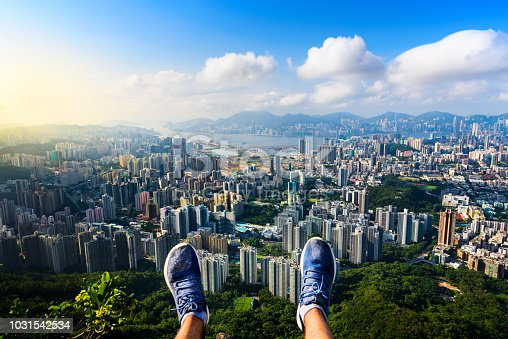 Man enjoying Hong Kong view from the Lion rock first person view