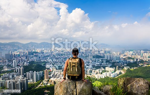Man enjoying the Hong Kong view from the Lion rock