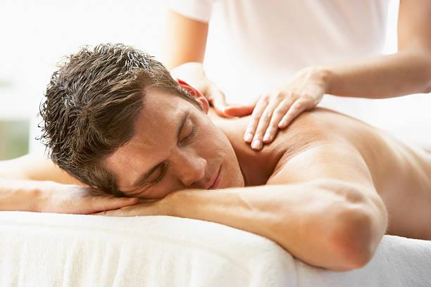 Man Enjoying Massage At Spa stock photo