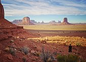 man enjoying the views in Monument Valley tribal navajo National park at sunset. Arizona. USA