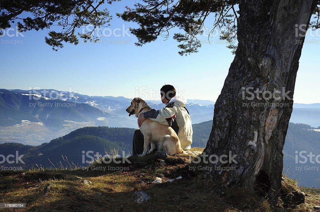 man enjoying mountain view with his dog stock photo